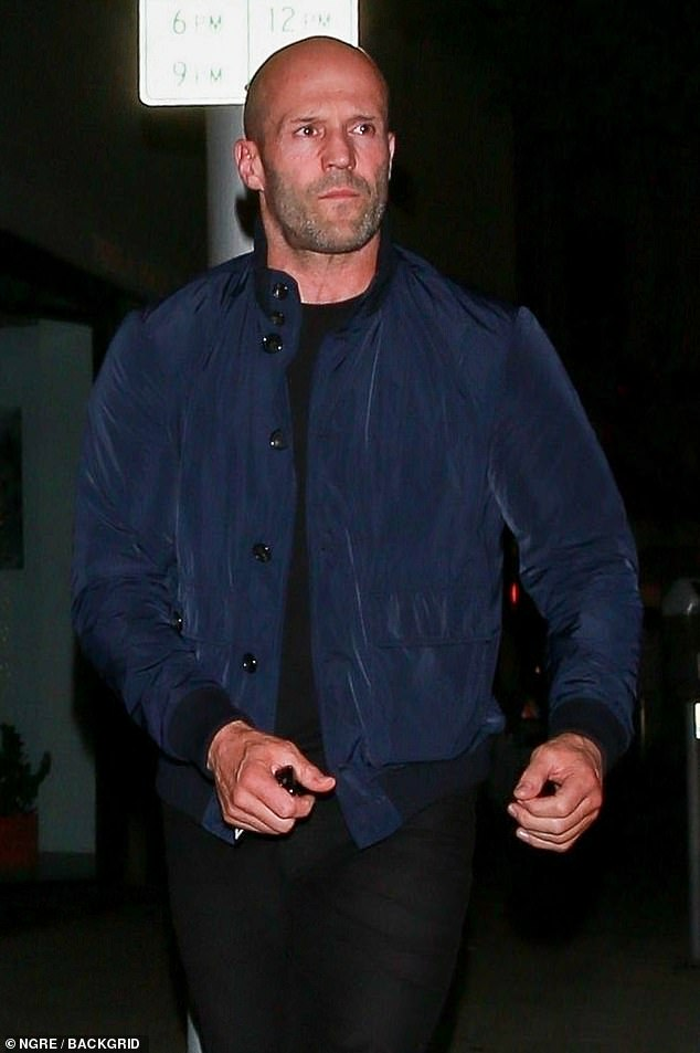 Smoulder: Jason looked handsome as he smouldered for the camera