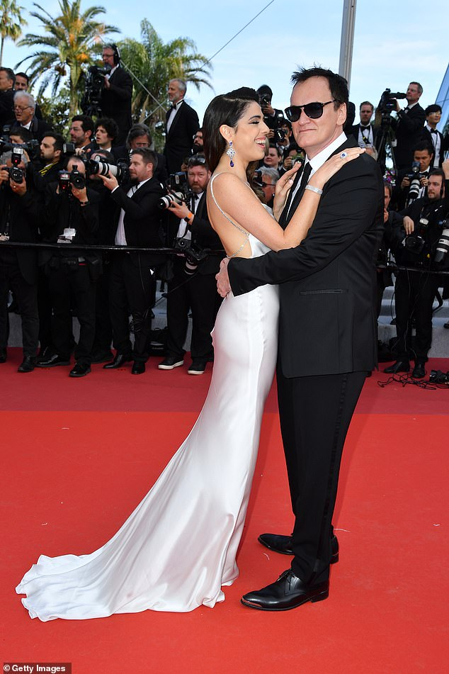 Absolutely smitten: The couple packed on the PDA as they strolled down the red carpet arm-in-arm