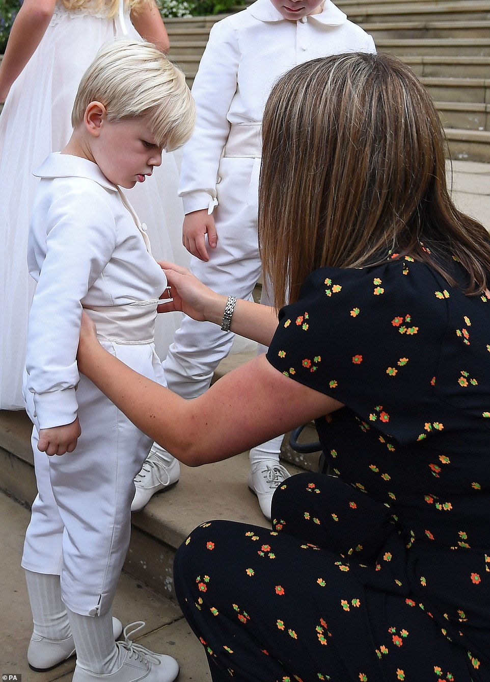 One adorable little boy was assisted with his outfits as he climbed the steps of St George's Chapel
