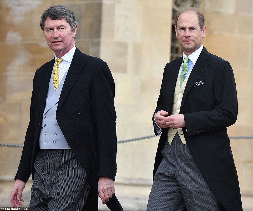 Tim Laurence (left), thethe second husband of Princess Anne, arrives for the wedding with Prince Edward (right)