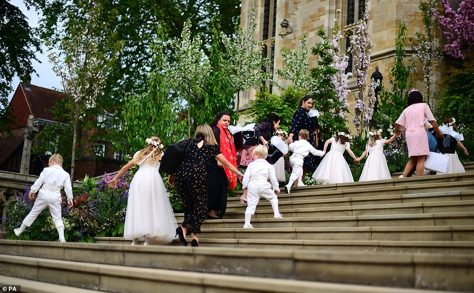 Pageboys and bridesmaids are led in ahead of the wedding of Lady Gabriella Windsor and Thomas Kingston