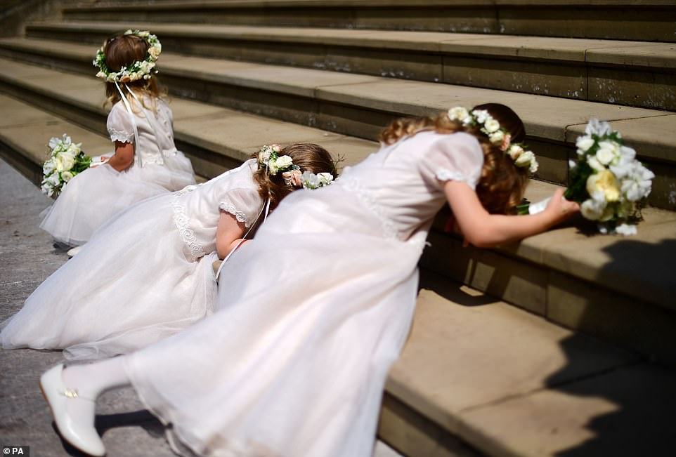 Bridesmaids were later seen lying prone on the steps of St George's Chapel at Windsor Castle following the wedding