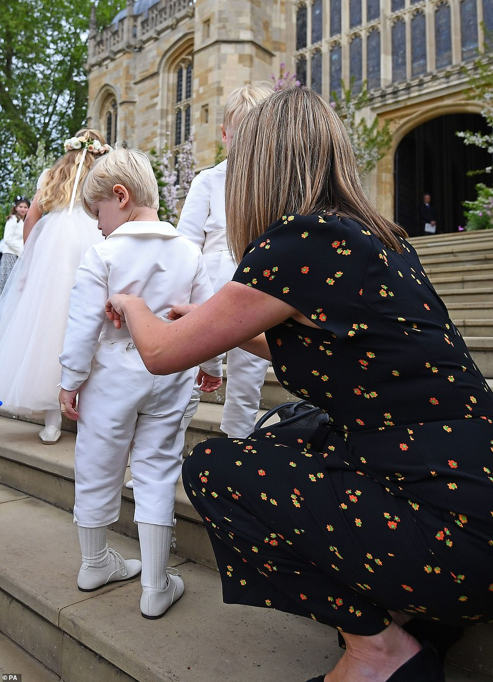 The pageboys donned all white outfits with matching shoes for the event at St George's Chapel in Windsor