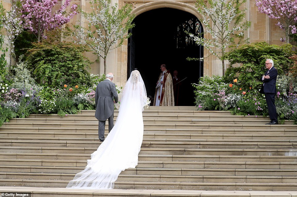 Lady Gabriella Windsor walks into the chapel with her father Prince Michael of Kent for her wedding