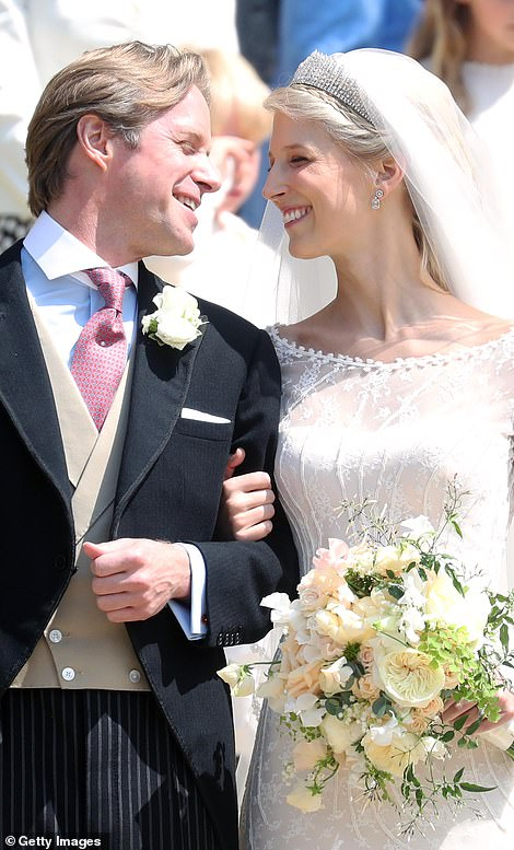 The newlyweds smile at Windsor Castle