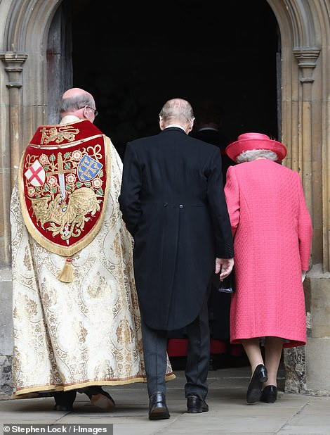 The Queen and Prince Philip are followed into St George's Chapel by the Dean of Windsor the Right Rev David Conner