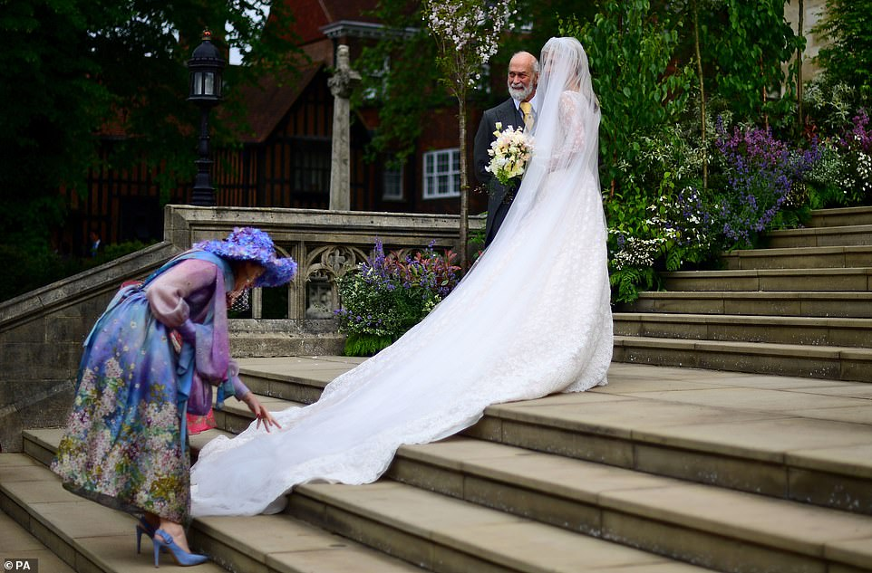 Lady Gabriella Windsor and her father Prince Micahel of Kent arrive at St George's Chapel in Windsor Castle - her six-metre long veil was designed byLuisa Beccaria