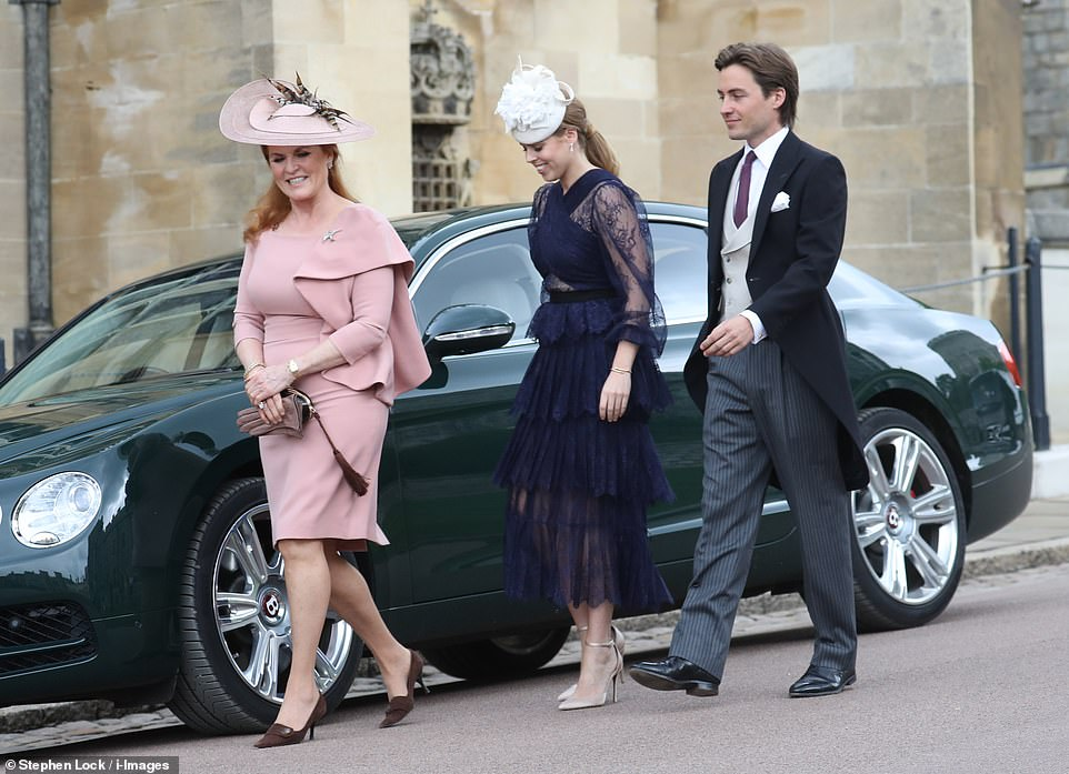 The Duchess of York arrives with her daughter Beatrice with her boyfriend Edoardo Marpelli Mozzi for the wedding