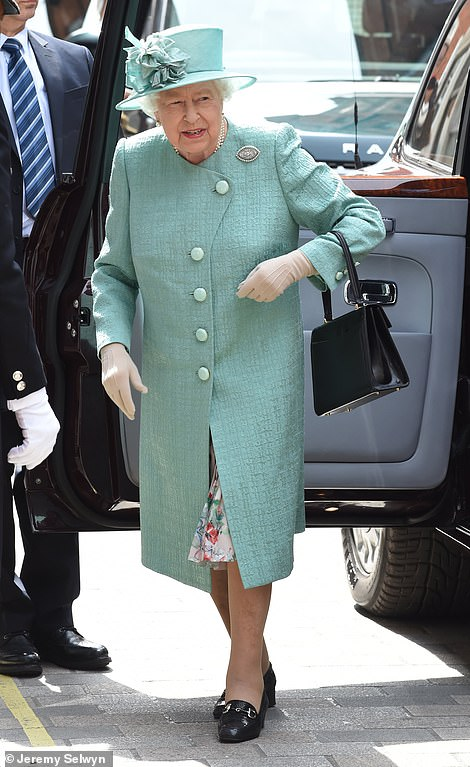 The monarch wore her coat over a floral dress