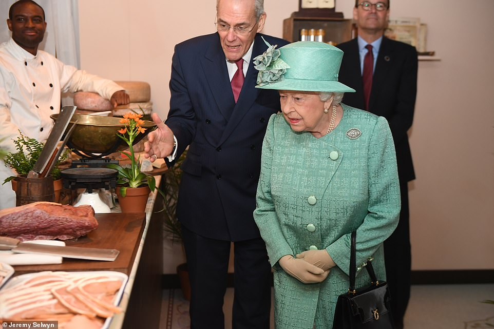 The Queen, who does not go to the supermarket herself, was talked through the different sausages and bacon on offer