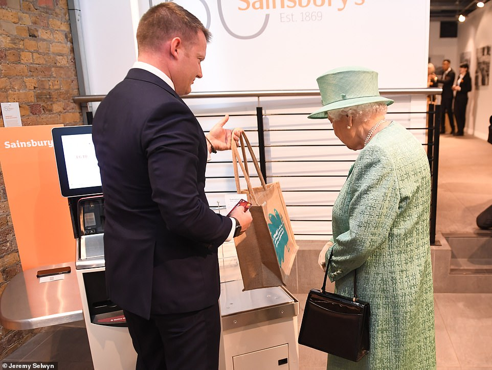 The Queen's visit culminated in an explanation of the self-service tills, as seen above. Her Majesty was also told how shoppers can now skip the tills completely by using an app on their phone to pay instead. The Queen described the tool as 'interesting'