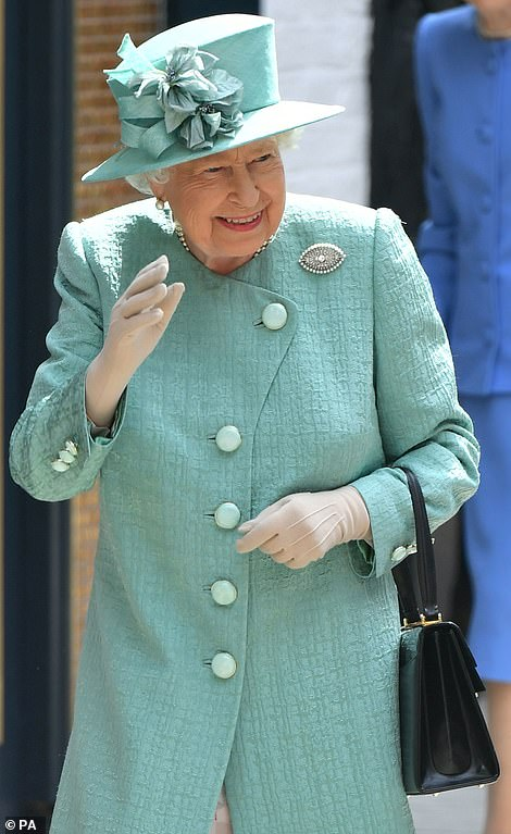 The Queen waves as she arrives at the pop-up store