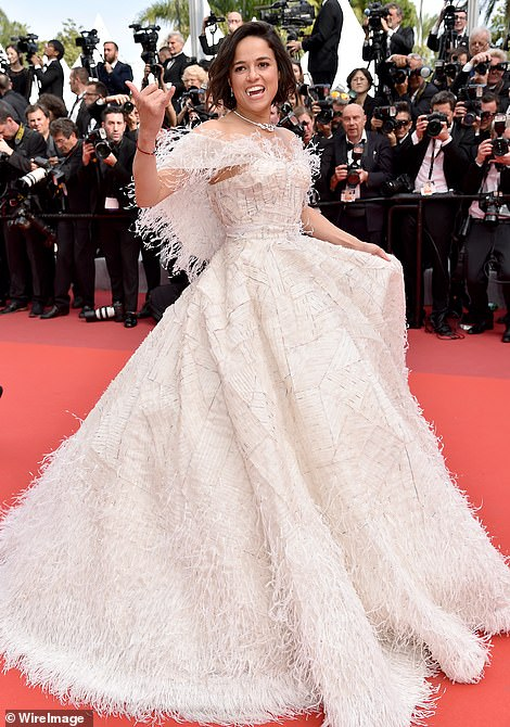 A vision:Michelle Rodriguez wore sizzling white gown with feathered details