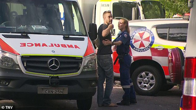 A distraught man, believed to be a relative, was seen being consoled by paramedics and gesturing in dismay at the lookout's car park