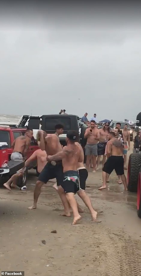 Men could be seen pounding each other over the head