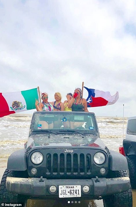 Others with a Texas and a Mexican flag flying in their jeep with the top down