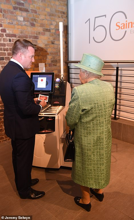 The Queen learning about the self-service checkout today