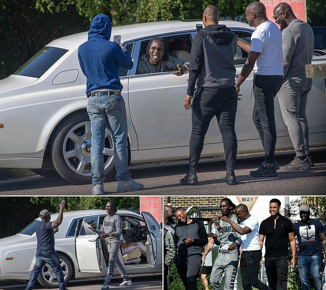 Prisoner is met by entourage after being released from jail before hopping into a