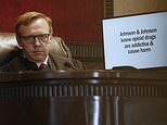 Judge Thad Balkman listens during opening arguments for the state of Oklahoma Tuesday, May 28, 2019, in Norman, Okla., as the nation's first state trial against drugmakers blamed for contributing to the opioid crisis begins in Oklahoma. At right is a slide from the state's presentation shown on a monitor. (AP Photo/Sue Ogrocki)