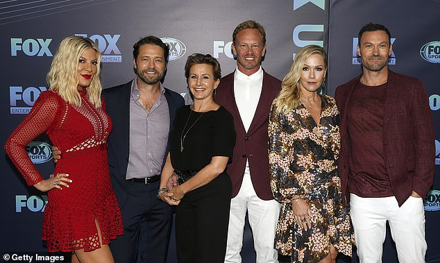 Missing something: Tori Spelling, Jason Priestley, Gabrielle Carteris, Ian Ziering, Jennie Garth and Brian Austin Green will revive Beverly Hills 90210 without their former co-star Luke Perry (Pictured May 13 in New York City)