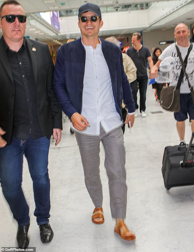 Dapper arrival: Orlando Bloom looked dapper as he touched down at Nice airport, ahead of Wednesday's glitzy events during the 72nd annual festival