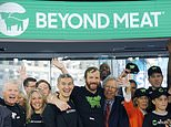 FILE - In this May 2, 2019, file photo Ethan Brown, center, CEO of Beyond Meat, attends the Opening Bell ceremony with guests to celebrate the company's IPO at Nasdaq in New York. Plant-based meat maker Beyond Meat beat Wall Street's expectations in its first earnings report since its IPO last month. The El Segundo, California-based company lost $6.6 million, or 95 cents per share, in the first quarter, up slightly from a 98-cent loss in the same period a year ago. (AP Photo/Mark Lennihan, File)