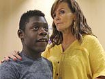Jerri Hrubes stands next to her son DJ during a news conference Friday, June 7, 2019, in Salt Lake City. Hrubes is calling for an independent investigation after she says a police officer pointed a gun at her 10-year-old son's head in what she calls a racially motivated incident. Hrubes said that a white Woods Cross police officer pulled his gun on her son, DJ, who is black, while he was playing on the front lawn Thursday, June 6, 2019. She says the officer came back to apologize after she called to complain, but that she wants the officer and the agency held accountable. (AP Photo/Rick Bowmer)