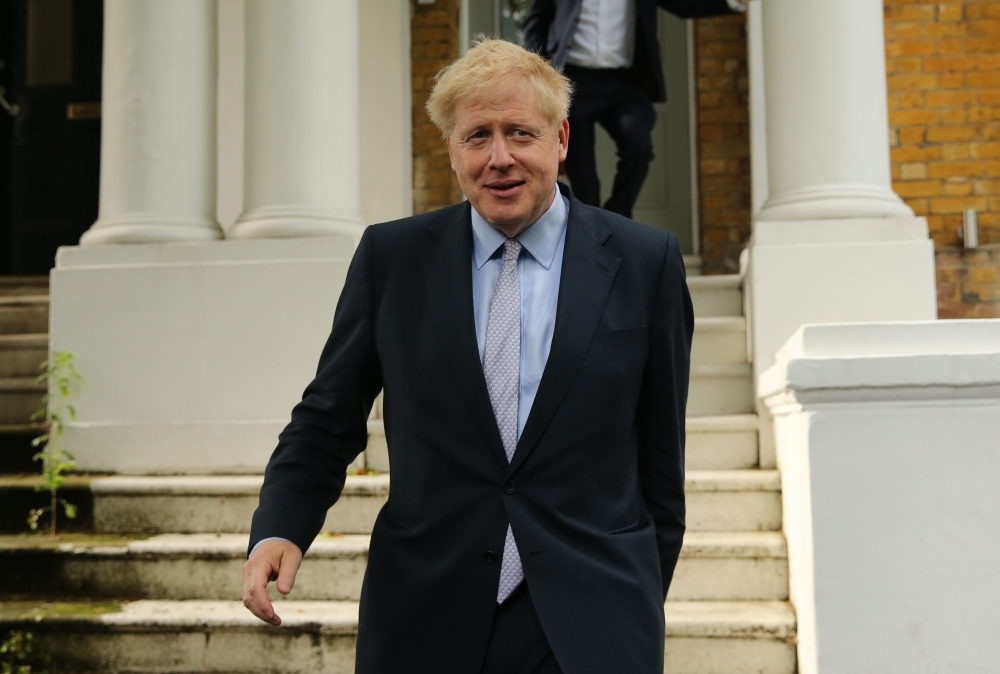 Conservative MP Boris Johnson leaves his home in London on Tuesday. — AFP