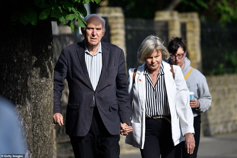 Outgoing leader of the Liberal Democrats Vince Cable and his wife Rachel Smith voting in Twickenham today