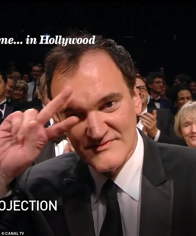 Game: The film's director, Quentin Tarantino, 56, tried gamely to play up to the camera, mimicking John Travolta's signature dance from Pulp Fiction not once but twice as the camera failed to move on from his face