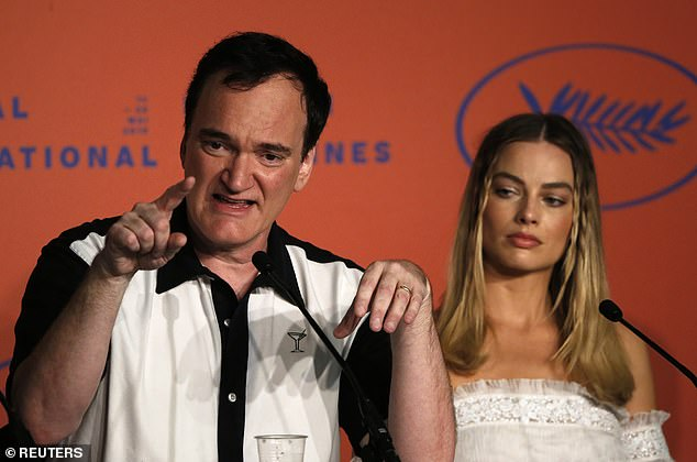 Not happy: Quentin Tarantino, 56, delivered a fiery response when quizzed about his portrayal of women in his films during the press conference for Once Upon A Time In Hollywood