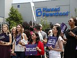 "FILE - In this June 4, 2019, file photo, anti-abortion advocates gather outside the Planned Parenthood clinic in St. Louis. Missouri's only abortion clinic, already facing the threat of losing its license, is no longer performing a medical procedure required by the state, calling the procedure ""disrespectful and dehumanizing."" A Planned Parenthood spokeswoman confirmed a CBS News report that as of Thursday, June 20 the St. Louis clinic no longer performs a pelvic exam during a consultation days before an abortion, as required by the state health department. (AP Photo/Jeff Roberson, File)"