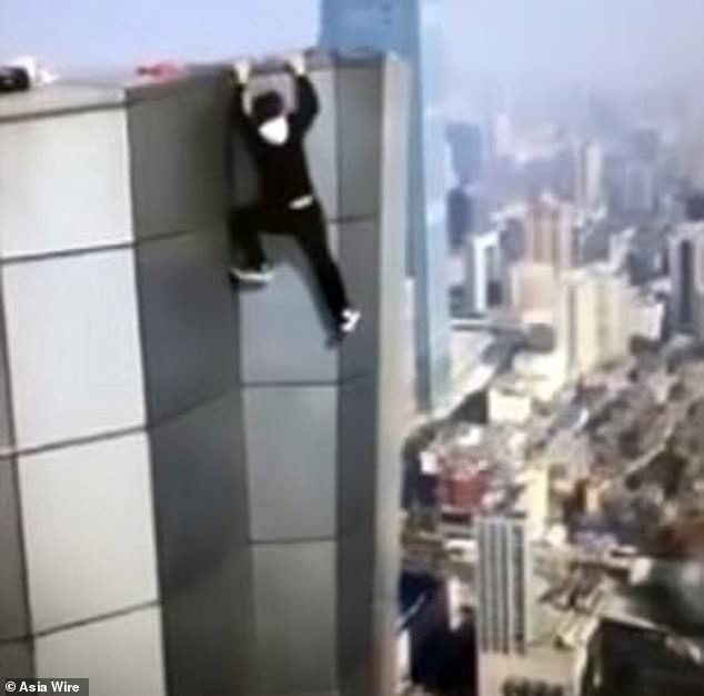 Harrowing footage filmed on November 8 captured the moment he let go of the side of the building, plunging 45ft on to a terrace below where his body was later found by a cleaner