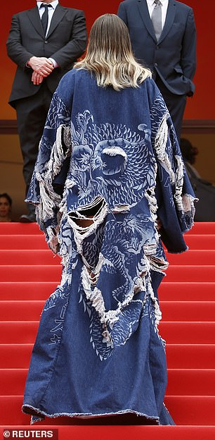Wow: The jacket was adorned with images of big cats as the star strolled up the stairs