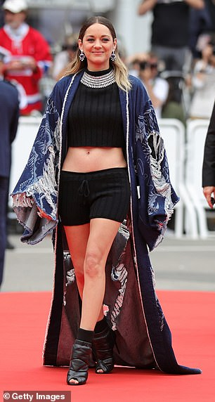 Gorgeous: The star looked classically beautiful as she walked the red carpet