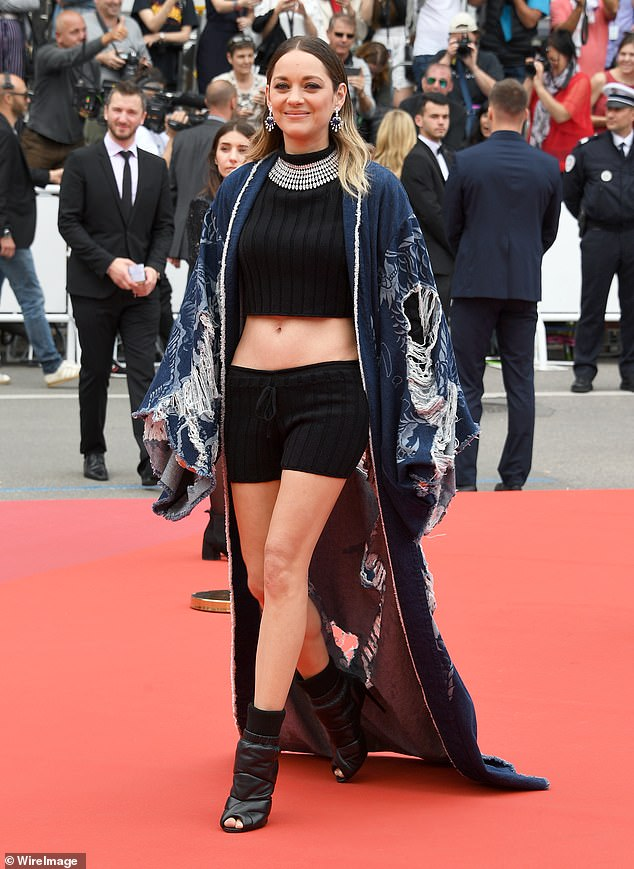 Strut:The star made the most of her long, lithe legs as she donned a pair of tiny black hotpants, teamed with leather peeptoe boots