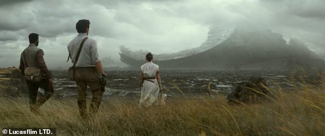 A bit of the past comes back: Poe, Finn and Rey look at part of the blown up Death Star