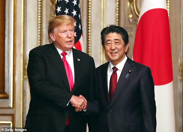 Trump is in Japan, where he held talks with Prime Minister Shinzo Abe (right). The two men discussed the North Korean threat
