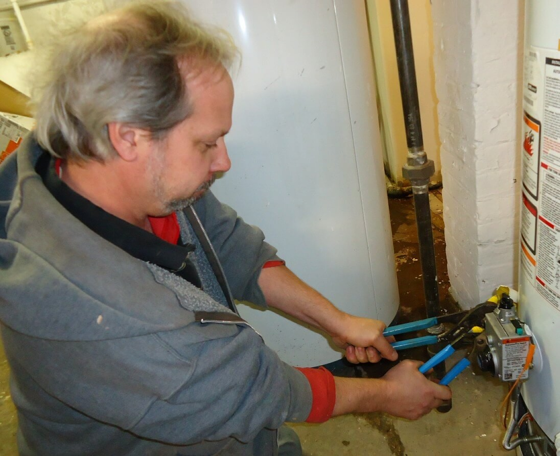 george plumber using a plumber wrench.jpg
