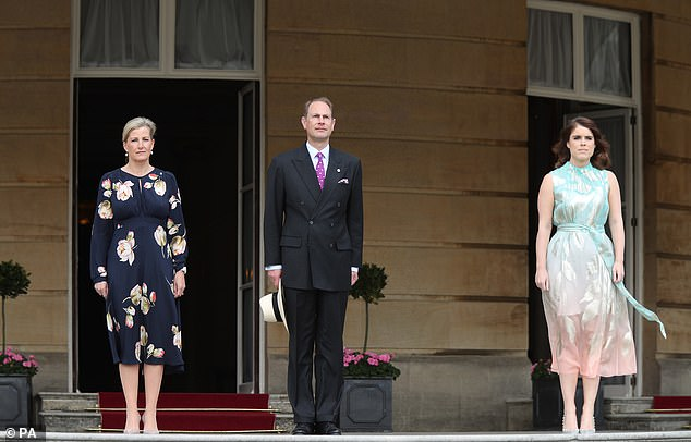 Sophie, Edward and Eugenie, pictured left to right, looked more serious before going into the garden to speak with the Duke of Edinburgh Gold Award recipients