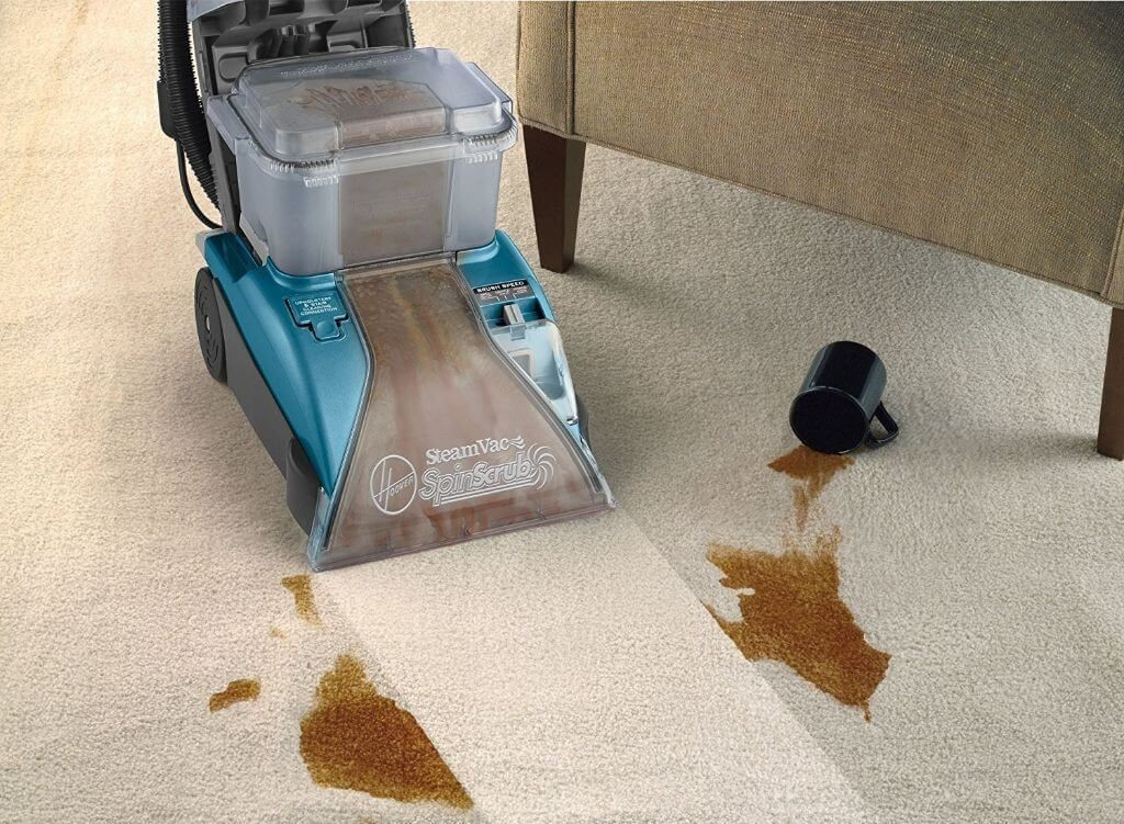 professional carpet cleaner cleaning a coffee spill.jpg