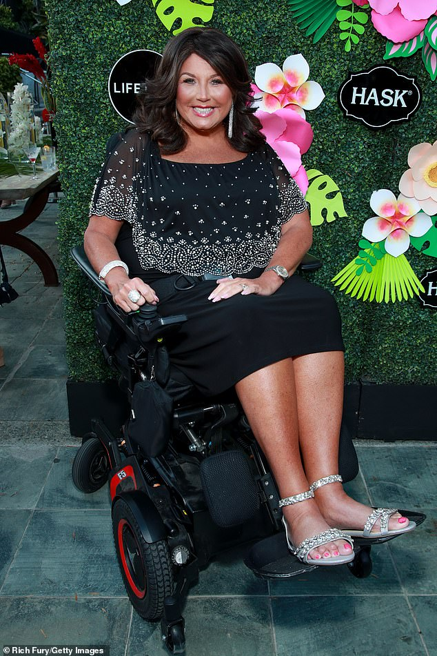 LBD: The cancer-free 52-year-old glittered in a black embroidered cocktail dress with silver bedazzled sandals and plenty of jewelry