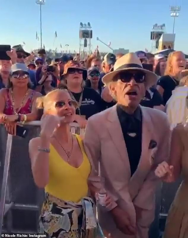 Weekend getaway: Richie was spotted in a canary yellow bathing suit while checking out some musical acts at the New Orleans Jazz and Heritage Festival on Saturday (pictured April 28 in New Orleans, Louisiana)