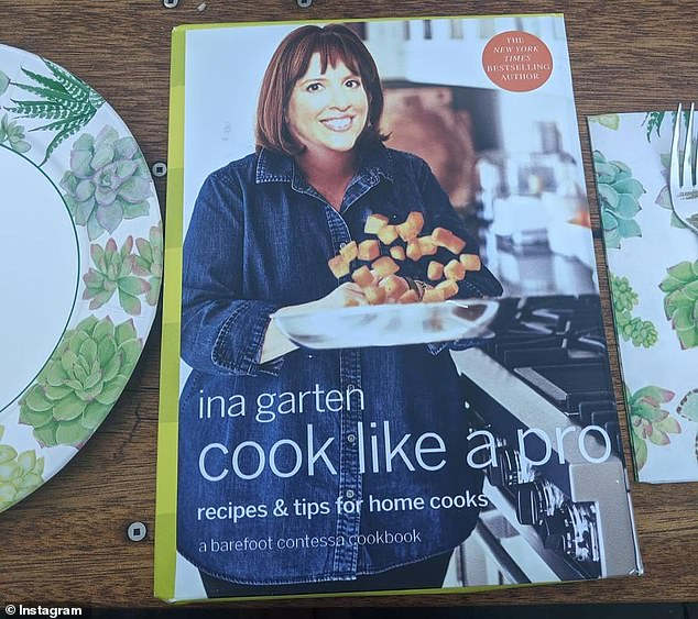 Going all out: Nicole was give a copy of Ina's new 'Cook Like a Pro' cookbook, which has her face superimposed over the celebrity chef's