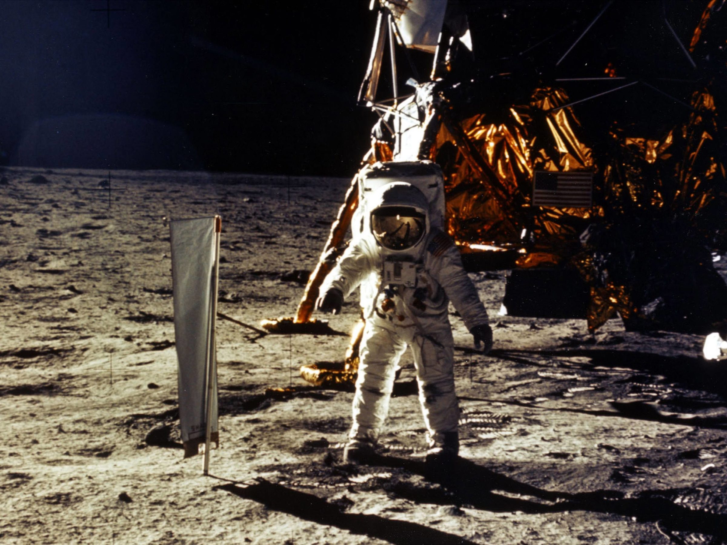 The deployment of scientific experiments by Astronaut Edwin Aldrin Jr. is photographed by Astronaut Neil Armstrong. Man's first landing on the Moon occurred July 20, 1969 as Lunar Module