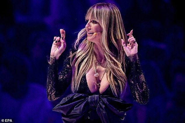 Revealing!:Heidi Klum turned to fellow 90s supermodel Tyra Banks, who created America's Top Model, at the live final of Germany's Next Topmodel in Dusseldorf on Thursday