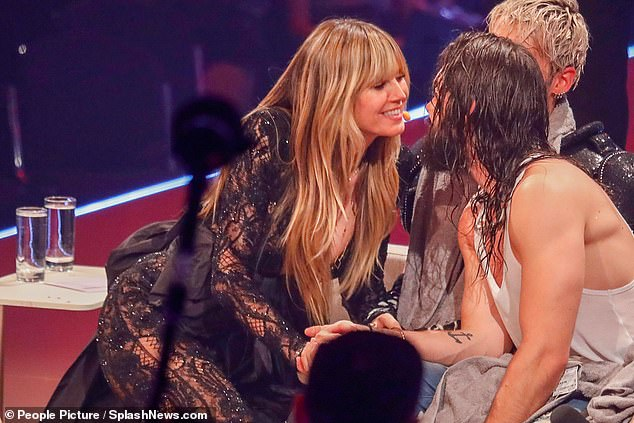 Proud: Heidi ran over to her toyboy beau after his impressive performance during the final