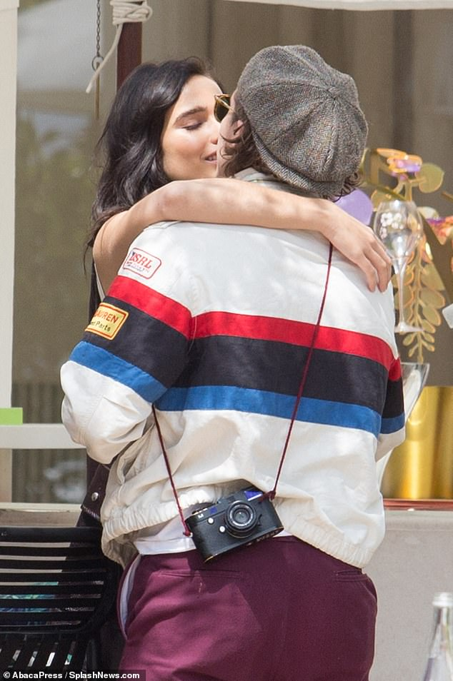 Smitten: Brooklyn Beckham and his girlfriend Hana Cross packed on the PDA as they enjoyed an al fresco lunch during the 72nd annual Cannes Film Festival on Wednesday afternoon