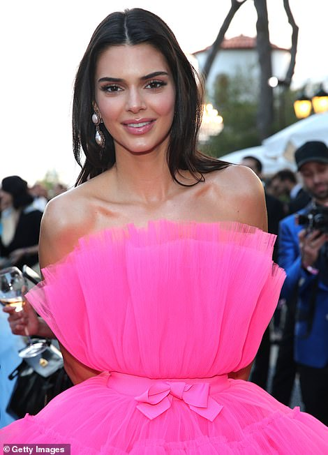 Radiant: Kendall drenched her plump pout in frosted pink gloss as she posed up a storm