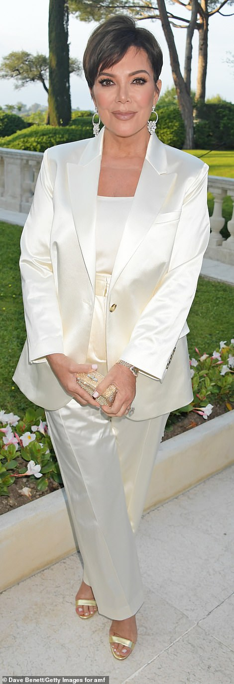 Yes! The Keeping Up With The Kardashians matriarch looked fabulous in a white satin suit with a sparkling gold clutch and high heels